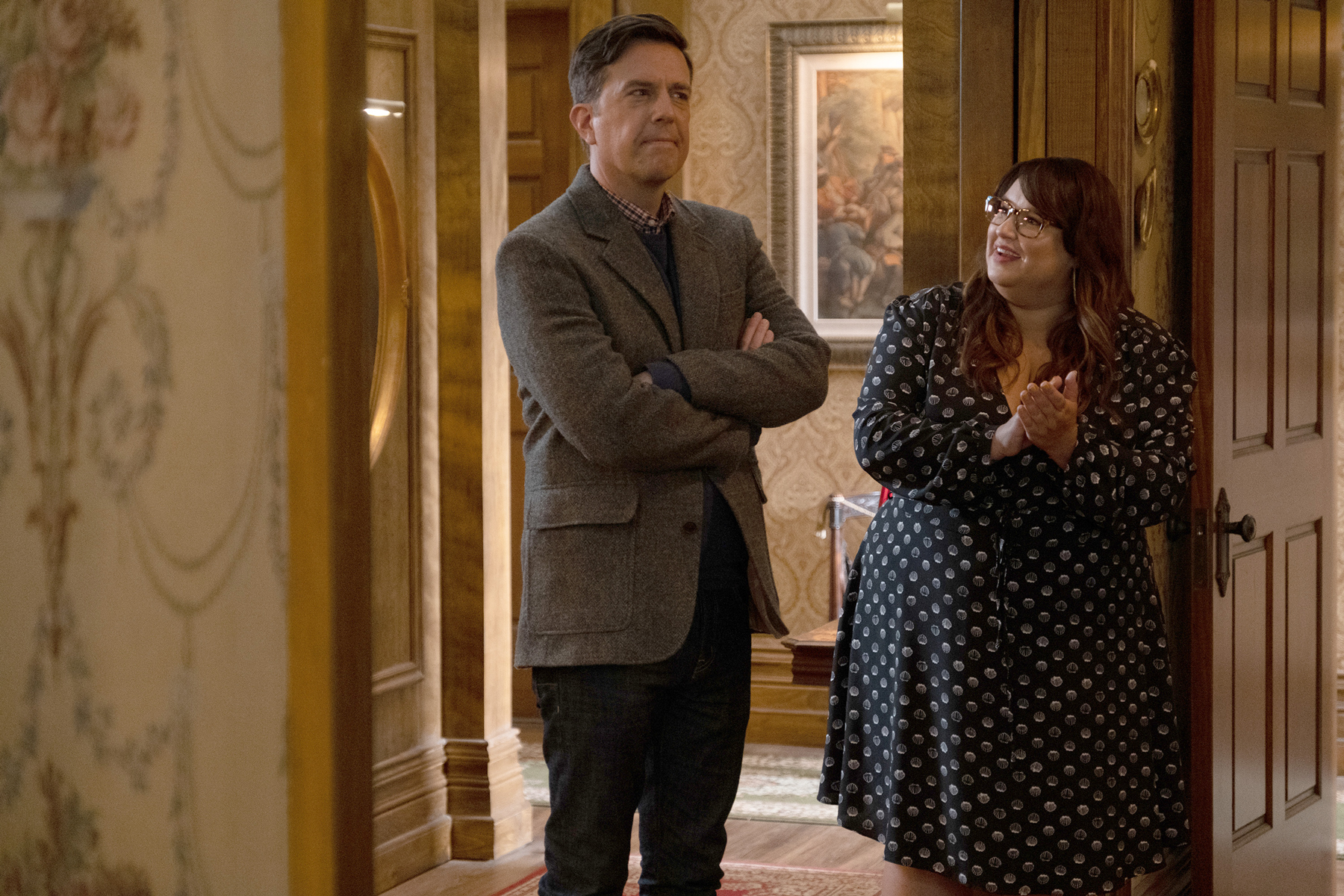 """RUTHERFORD FALLS -- """"Pilot"""" Episode 101 -- Pictured: (l-r) Ed Helms as Nathan Rutherford, Jana Schmieding as Reagan Wells -- (Photo by: Colleen Hayes/Peacock)"""