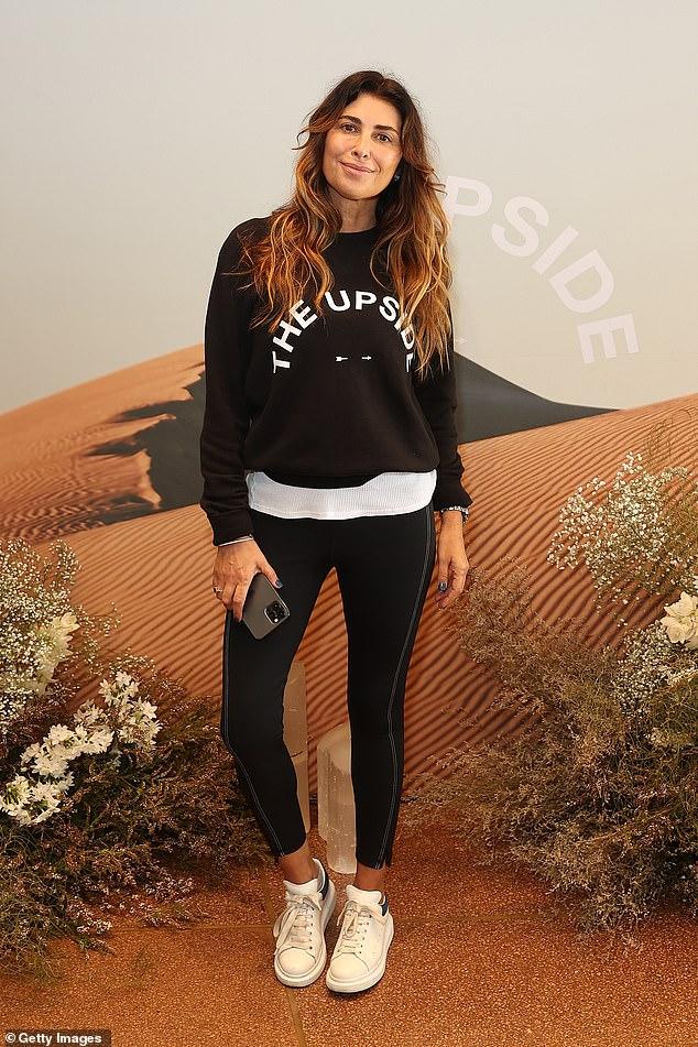Representando a la marca: Jodhi Meares fue su mejor anuncio antes de la exhibición en la pasarela de su marca de ropa deportiva The Upside en la Semana de la Moda Australiana en Sydney el viernes.