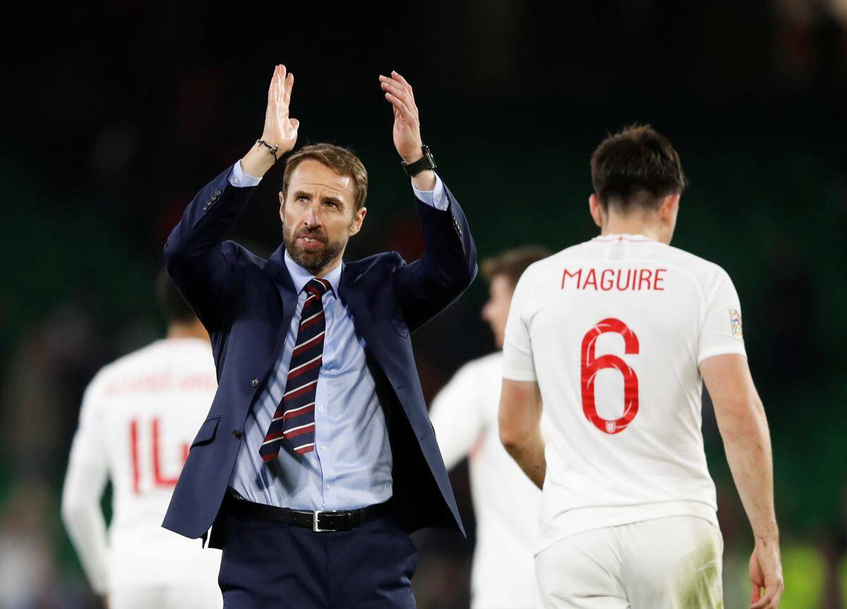 England manager Gareth Southgate applauds their fans after the match against Spain
