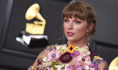 Taylor Swift poses in the press room at the 63rd annual Grammy Awards at the Los Angeles Convention Center on Sunday, March 14, 2021. (Photo by Jordan Strauss/Invision/AP)