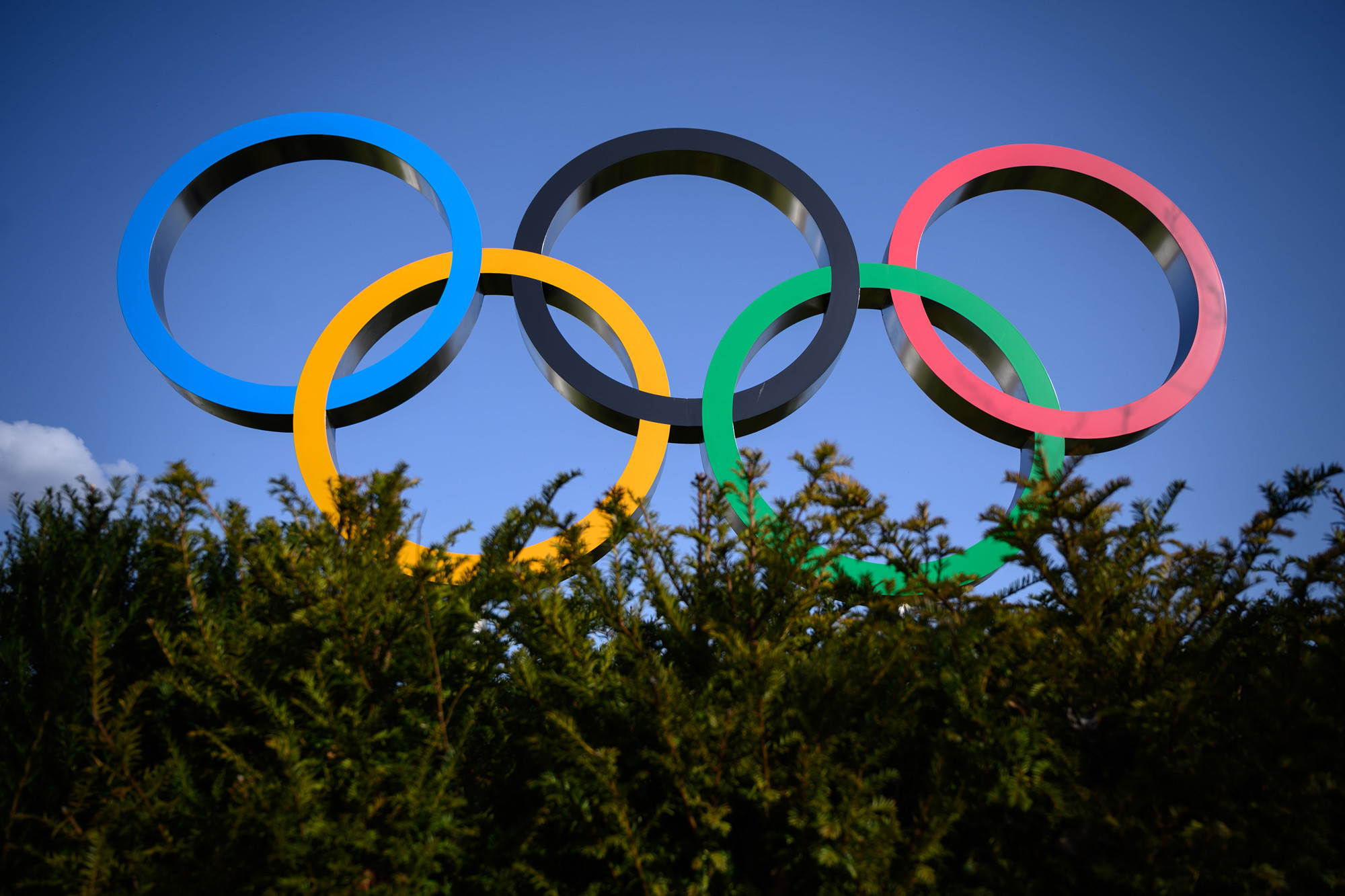 The Olympic Rings are pictured next to the headquarters of the International Olympic Committee (IOC) in Lausanne on March 21, 2020, as doubts increase over whether Tokyo can safely host the summer Games amid the spread of the COVID-19. - The global sporting calendar has been swept away by the coronavirus pandemic but the International Olympic Committee has insisted the Tokyo Games will go ahead in four months despite growing calls for a postponement. (Photo by Fabrice COFFRINI / AFP) (Photo by FABRICE COFFRINI/AFP via Getty Images)