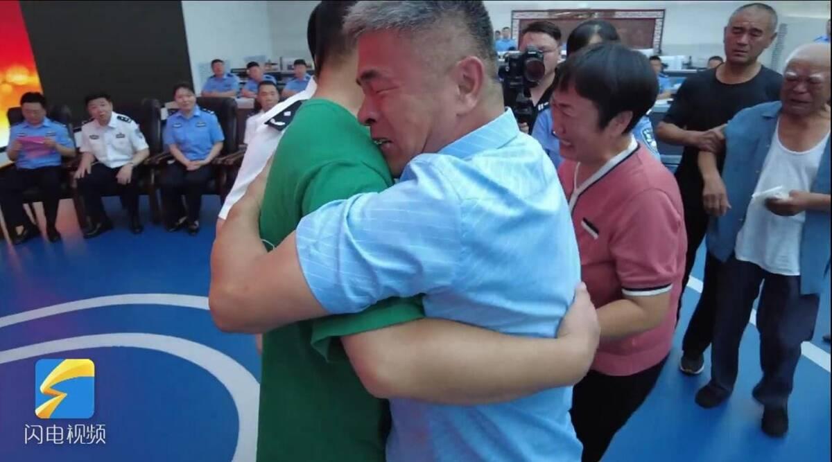 China man hugging his son