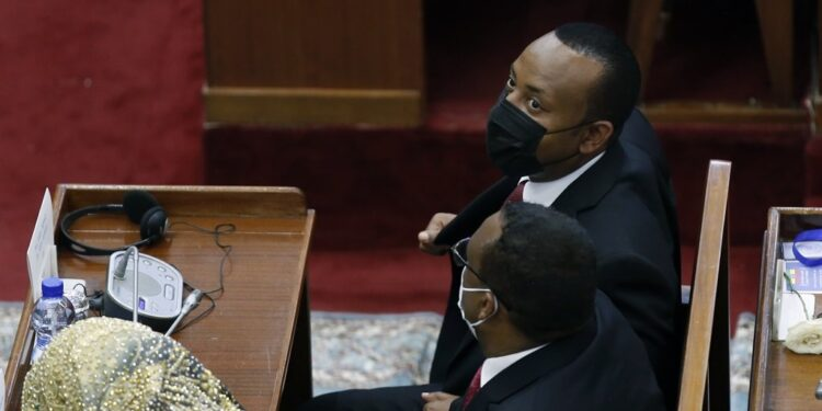 Abiy Ahmed Ali (R) took the oath of office during the joint session of the House of Peopleâs Representatives and House of the Federation held on Monday in Addis Ababa, Ethiopia on October 4, 2021.