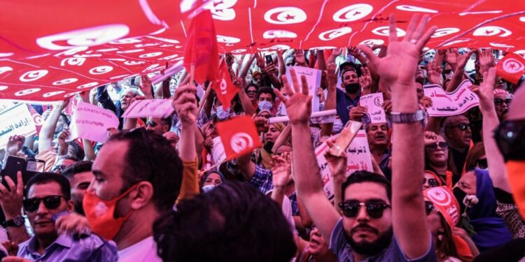 People take part in a protest supporting Tunisian President Kais Saied. (Photo by Khaled Nasraoui/picture alliance via Getty Images)